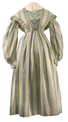 Date:1830 - 1839 (c.)    Description: A cotton day dress with matching shawl. Blue, with printed pattern of green with black spots and yellow squares.