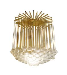 Monumental chandelier composed of multiple suspended glass ball elements featuring a brass starburst canopy.