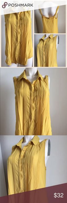 Anthropologie sleeveless top Gorgeous mustard colored sleeveless top by Lost April from Anthropologie. Button up style,open back has a color. Flowy fabric. Anthropologie Tops