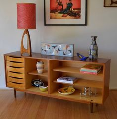 The doors on this vintage sideboard were beyond repair and removed but still looks great! - Via