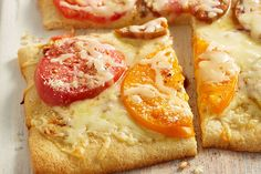 Enjoy a delicious slice of our Heirloom Margherita Pizza at dinnertime! Using refrigerated pizza crust makes Margherita pizza a quick weeknight dish.