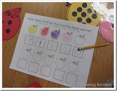 Growing Kinders - Counting apple seeds:  the children worked on 1:1 correspondence, counting and number writing with this center.