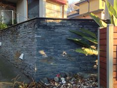This rustic #stacked #stone wall in Glen Waverley really fits well with the landscaping, the overall impression is one of a relaxed yet  modern home.