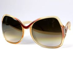 Vintage Christian LATOUR sunglasses. Clear frame with white temples. Measurements: front of frame 140mm bridge 18mm lens 56mm x 57mm temple length 125mm  In very good vintage condition. Minor signs of wear and age.  ******************************************************************************  Please do not hesitate to contact for any further details.  Also please check the shop policies. This will help to avoid any misunderstanding in communication…