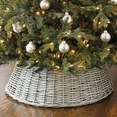 This sturdy Christmas Tree Basket is a natural alternative to a traditional tree skirt and adds lots of rich texture at the same time. It's hand woven of willow and finished in a neutral washed gray that blends.