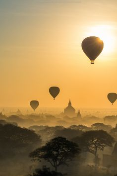 Sunrise and hot air balloons over the ancient temples in Bagan, Burma. Bagan is an ancient city hidden deep inside Burma. At the height of the Kingdom of Pagan, the city had over 10,000 Buddhist temples. Today, over 2200 of these are still standing, making it an amazing place to visit.