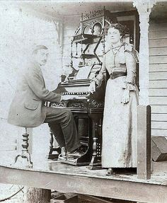 https://flic.kr/p/7vCzqv | ... long before flash or digital photography | The ornate reed organ has been moved onto the porch for this vintage photograph to be taken.
