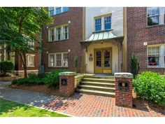 22 Collier Rd NW #4 - Highly desirable, historic condo in Manchester loaded with old-world charm & character near Ardmore Park. End unit light all day, ground floor, reno. in 2005 w/ new kitchen & bathroom. Gorgeous hrdwd flrs, repainted. Seller hates to leave, after making numerous major upgrades: Carrier HE HVAC w/ humid & dehum, HE H2O heater & washer/dryer, gas cooktop, electrical panel. Low future ownership costs. Spacious living rm, separate sunrm could be dining rm or office, built-in…