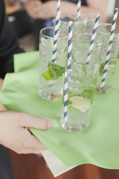 mojito served at wedding with corresponding colors of navy white and lime green #weddingdrink #weddingreception #weddingchicks http://www.weddingchicks.com/2014/01/29/seaside-wedding-3