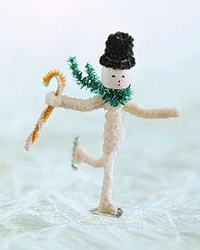 """Snowman: Fold a standard pipe cleaner in half. Slide a wooden bead over fold for a head, leaving a loop at top. For arms, twist a 3"""" pipe cleaner once under bead; then wind a full pipe cleaner around torso, below arms. Shape hat from a 6"""" strip of narrow black chenille that has been wrapped around a pencil. Use hot glue to attach wire-tinsel skates; crimp up feet for best bond. Draw in a face with a felt-tip pen. Add a cane + a striped chenille scarf, and off he glides."""