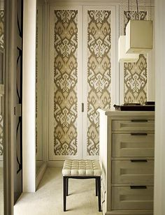 Paper covered door panels in dressing room.  Do this with textured wallpaper or maybe those wall grid things?