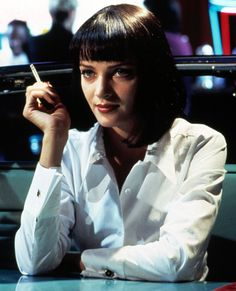 Pulp Fiction's Mia Wallace (played by Uma Thurman) is instantly recognizable for her trademark blunt bob, bangs—and white shirt, of course.