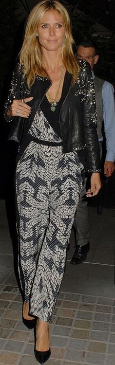 93625cc2ef8c Who made Heidi Klum s white print wrap jumpsuit and black studded leather  jacket that she wore in New York  (OutfitID)