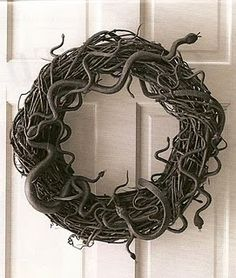 Plastic snakes glued to a wreath and spray painted black. Cool for Halloween.