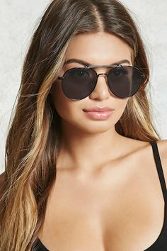 A pair of aviator sunglasses featuring tinted lenses, a curved nose bridge, and a brow bar.