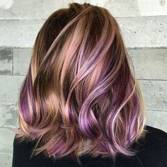 Love this dark brown hairstyle with beautiful blonde and purple highlights