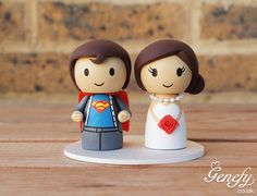 Cute superman and bride wedding cake topper  https://www.facebook.com/genefyplayground