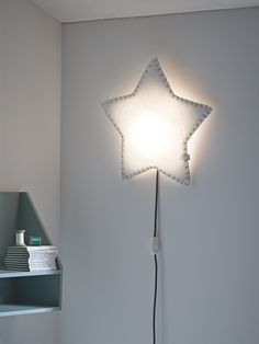 Individually handmade in Spain, each wall light is crafted from sustainable materials and hand sewn into a cute star shape. Made from recycled bottles, the soft polyester and quirky hand stitching makes this beautiful light truly unique. When mounted on the wall, the LED bulb shines through the soft material to cast a warm glow across the room - perfect for reading bedtime stories.  Also available in a sweet heart or fluffy cloud shape.