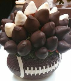 Superbowl party food appetizer or dessert football edible arrangement with chocolate covered strawberries