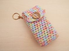 Hand crochet pocket tissue cover keyring - pastel colour mix with wooden button on Etsy, £3.50