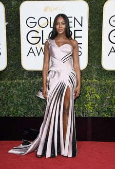Model and presenter Naomi Campbell showed off her incredible body in a black and pink one-shoulder dress to attend the 74th Annual Golden Globe Awards at The Beverly Hilton Hotel.