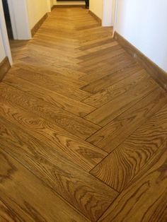 Herringbone Parquet Flooring in hallway.   Supplied and Installed.   Parquet flooring delivery and installation for commercial and residential projects.