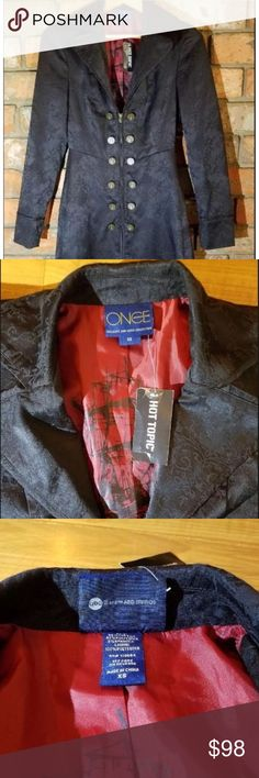 Hot Topic Once Upon a Time Hook Coat Fit Flare XS Hot Topic 'Once Upon a Time' XS Hook Long Coat Jacket Cosplay Fit Flare Storybrooke's limited edition collection. Black cotton jacquard princess coat with an allover ship and hook damask print. The front zipper closure has gold Hook buttons on both sides of jacket. Inside, a satiny burgundy lining with an elaborate black print of Hook's ship with mermaids in center. Body: 55% cotton; 42% polyester; 3% spandex Lining: 100% poly Approx…