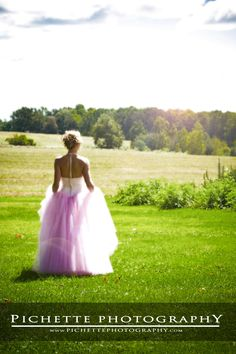 Senior in a field / prom dress