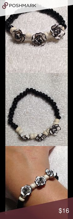 Black Agate and White Turquoise Rose Bracelet Very cute and stylish! This piece is made from genuine black agate and white turquoise beads. It is elastic, so to will stretch to fit. Jewelry Bracelets