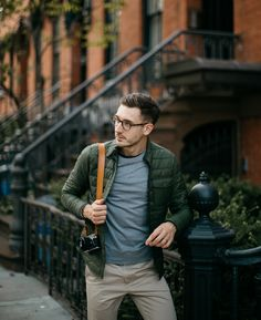 Fall is here, and time for men to update their style, checkout this outfit, made up a green quilted jacket, sandy pants, grey sweater and navy t shirt.
