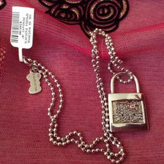 Hello Kitty Padlock Necklace Authentic NWT This Is An Authentic Hello Kitty Padlock & Chain So Sweet Look At Its Adorable Face And Is Hallmarked Of TheFinest Heavy 0.925 Silver And Still Has The Tag Beautiful Great Gift!, Hello Kitty Jewelry Necklaces