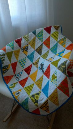 Rainbow Triangles Baby Quilt. $135.00, via Etsy.
