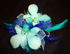 All Seasons Floral- Vibrant blue orchid wrist corsage perfect for prom!