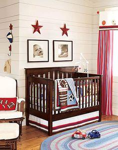 Quarto de bebê decorado com o tema esportes.