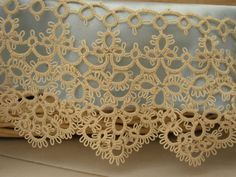 Beautiful tatted lace.  When I master tatting, I want to make a dust ruffle for my bed with an edging similar to this.