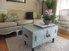 old trunk + paint +  wooden legs = cute & creative coffee table