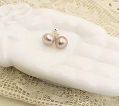 A personal favorite from my Etsy shop https://www.etsy.com/listing/246268468/dark-blue-grey-freshwater-pearl-earrings