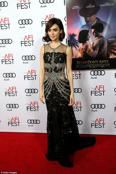 Show-stopper: Her dress featured silver beading and see-through panels which revealed her ...