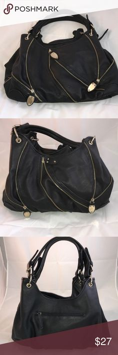 Slouchy chunky handbag w/lots of storage! Chunky handbag with lots of storage! Two compartments. One interior zippered pocket and two slide pockets. One exterior zippered pocket. Chunky hardware. Lots of exterior zippers for stylish trendy look. Small tears on lower front/handle. Bags Satchels
