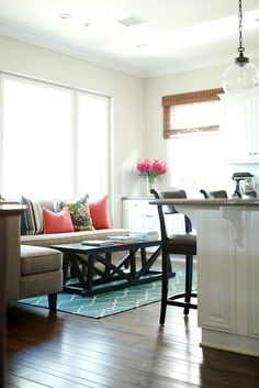 A pair of neutral wingback chairs create a small sitting for Kitchen sitting area