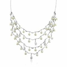 "Cascading Gorgeous Sterling Silver Waterfall Pearl and CZ Frontal Necklace Kezef. $59.99. Overall frontal size is approx 3.5""x6"". Eight dangling briolette cut CZ's. Four silver strands with dangling pearls and cubic zirconias. Forty dangling 4-4.3mm genuine white freshwater pearls  . Save 45%!"