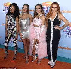Sizzling:Perrie Edwards stunned in a daring silver mini dress as she arrived at Nickelode...