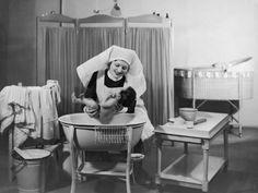 Uniformed Nurse Bathes a Baby in Hospital