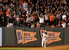 San Francisco Giants' Gregor Blanco (7) throws a ball into the left field bleachers before the start of the ninth inning during their game against the Arizona Diamondbacks at AT&T Park in San Francisco, Calif., on Tuesday, Sept. 9, 2014.  (Nhat V. Meyer/Bay Area News Group)