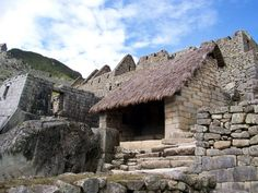 A restored building with a new roof at Machu Picchu