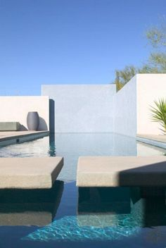 Pool with white walls.
