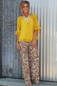 Love the style of the blouse with the palazzo pant. Perfect with heel or flat.