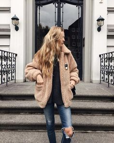 Faux fur jacket...anyone know who makes this? (The link the pin takes you to doesn't look anything like this pic.)