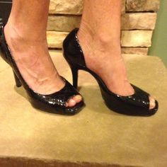 """Jessica Simpson Peep Toe Heels Black Patten peep toe heels in very good condition. Small slit on inside on shoe has shown in 4th pic. This does not mess up the integrity of the shoe at all. Price reflects. 4"""" heel. Jessica Simpson Shoes Heels"""