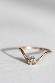This gold chevron ring with a tiny diamond would look perfect stacked with other delicate rings.